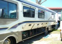 Storage compartments in a 5th wheel trailer and a class A motorhome